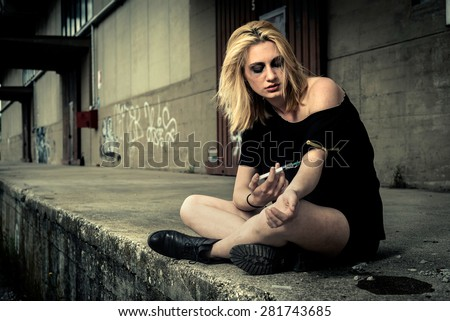 Teenage girl injecting drug - stock photo