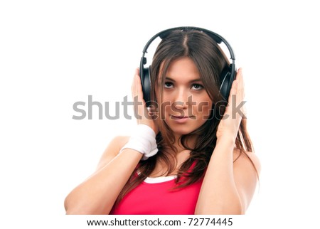 Teenage girl listen music in headphones isolated on a white background - stock photo
