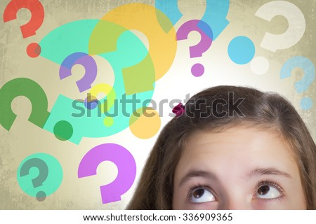 Teenage girl looking to multitude of colorful guestion marks expressing dilemma and hesitation. Grunge background.  - stock photo