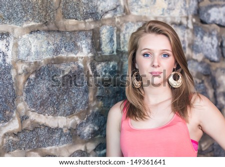 Teenage Girl old stone wall in background - stock photo