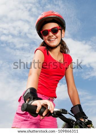 teenage girl on a bicycle - stock photo