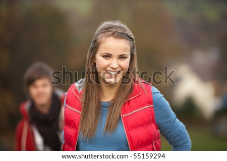 Teenage Girl Outside With Boyfriend In Background - stock photo