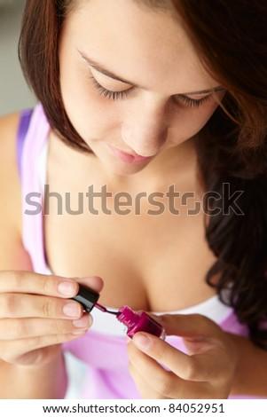 Teenage girl painting nails - stock photo