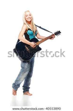 Teenage girl playing an acoustic guitar wearing jeans isolated on white - stock photo