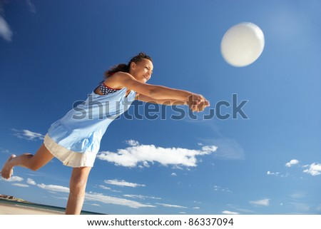 Teenage girl playing beach volleyball - stock photo