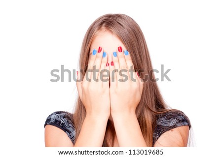 Teenage girl playing hide-and-seek, isolated on white - stock photo