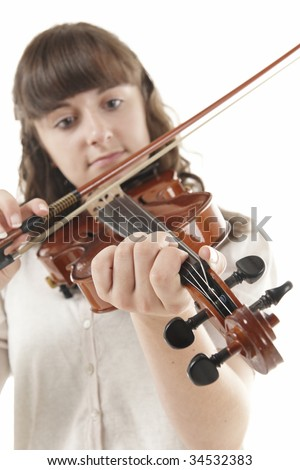 Teenage girl playing the Viola against a white background