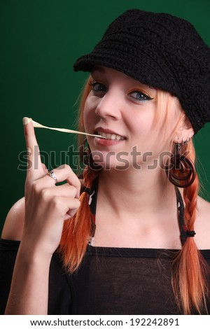 Teenage girl playing with a chewing gum - stock photo