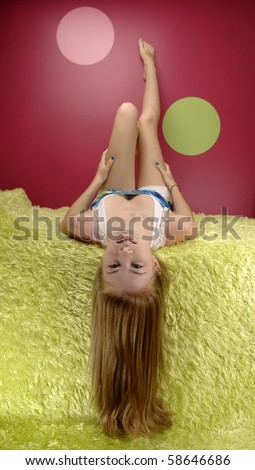 Teenage girl reads book in her room. - stock photo