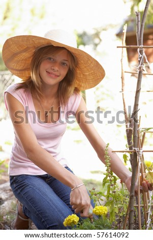 Teenage Girl Relaxing In Garden - stock photo