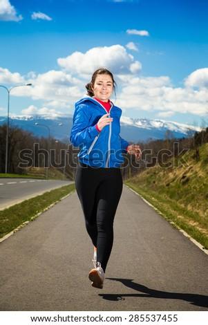 Teenage girl running, jumping outdoor  - stock photo
