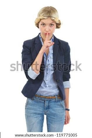 Teenage girl showing shh gesture - stock photo