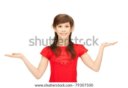 teenage girl showing something on the palms of her hands - stock photo