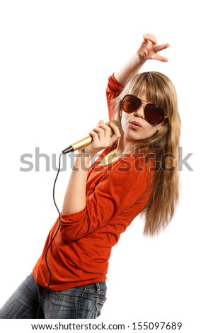 Teenage girl singing into a microphone on a white background - stock photo