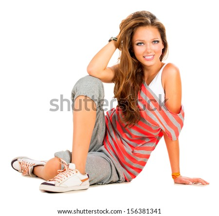 Teenage Girl sitting and Smiling. Beautiful Teen Girl Portrait. Isolated on a White Background. Teenager  - stock photo