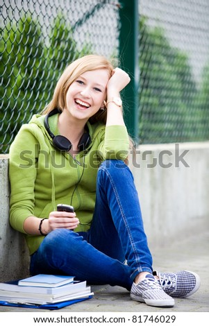 Teenage girl sitting outdoors