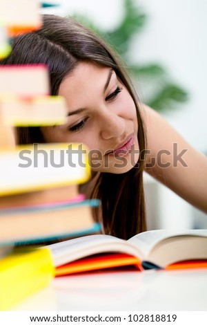 Teenage girl sitting with books and study, student�¢??s life - stock photo