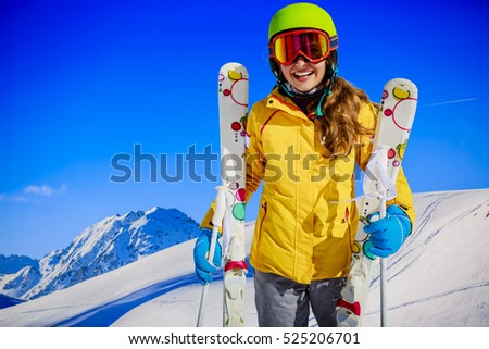 Teenage girl skiing in Swiss Alps in Sunny Day,