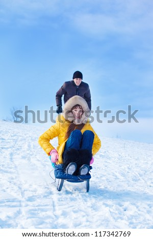 Teenage girl sliding down the hill - stock photo