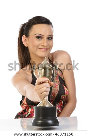 Teenage girl smiling with the gold trophy