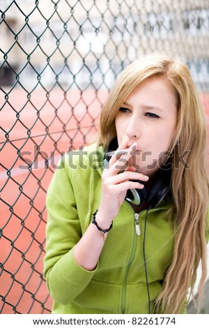 Teenage girl smoking - stock photo