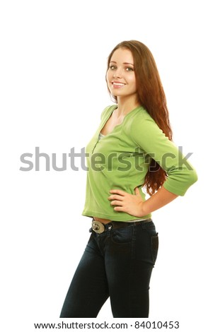 Teenage girl standing with hand on hip  isolated on white