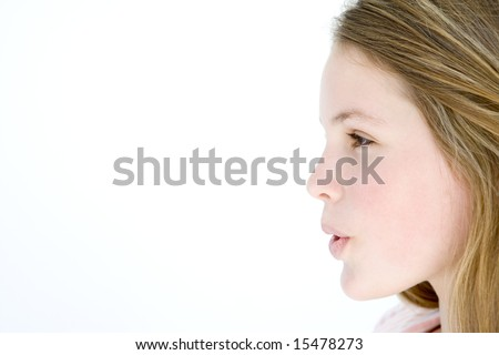 Teenage girl standing with mouth open - stock photo