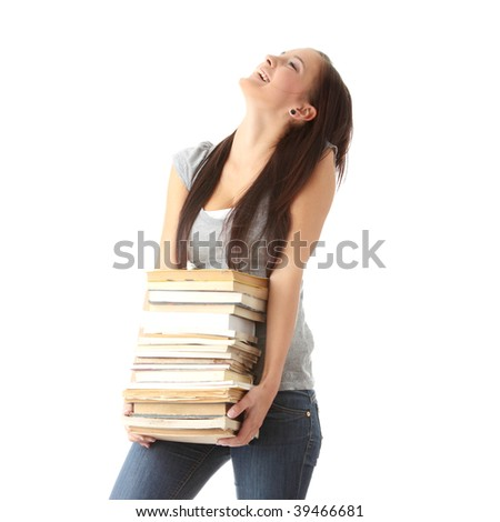Teenage girl struggling with stack of books isolated - stock photo
