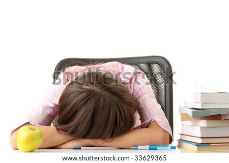 Teenage girl studying with textbooks - sleeping on table
