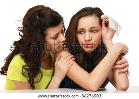 Teenage girl supporting her friend or sister isolated on white - stock photo