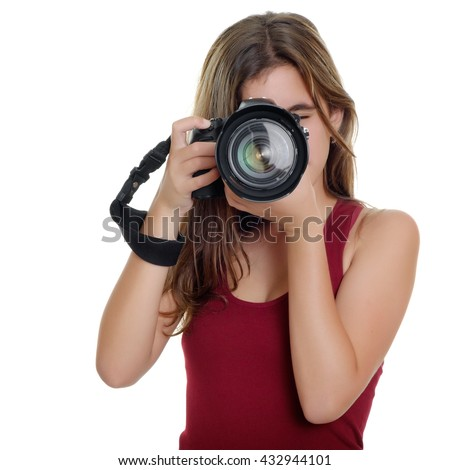 Teenage girl taking photographs with a professional camera isolated on a white background