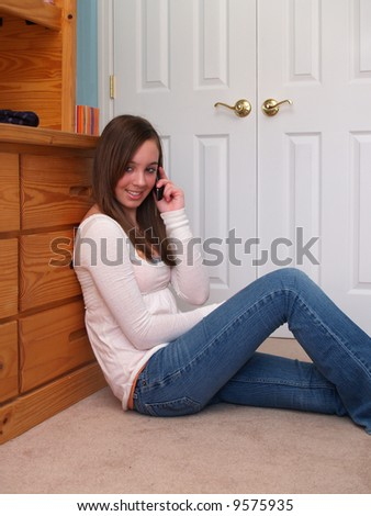 teenage girl talking on a cell phone