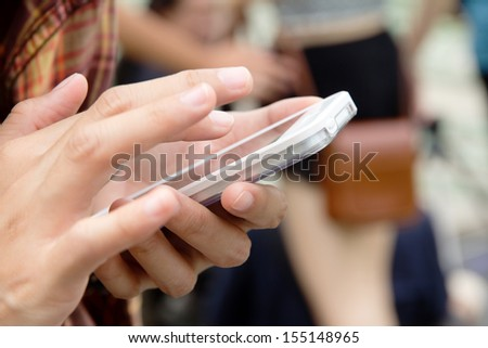 Teenage girl text messaging on her phone
