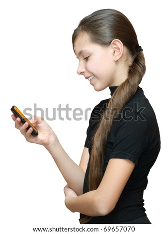 Teenage girl typing sms on the mobile phone. Isolated on white background. - stock photo