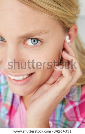 Teenage girl wearing earphones