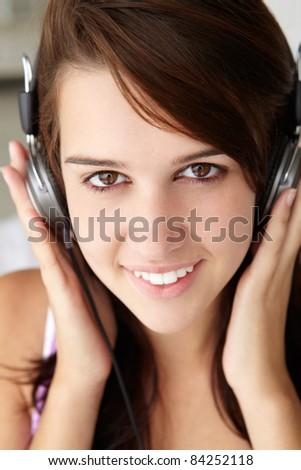 Teenage girl wearing headphones - stock photo