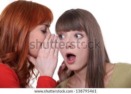 Teenage girl whispering - stock photo