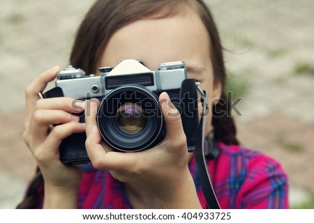 teenage girl with a camera. old photo camera. youth vintage lifestyle - stock photo