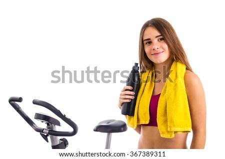 Teenage girl with bicycle - stock photo