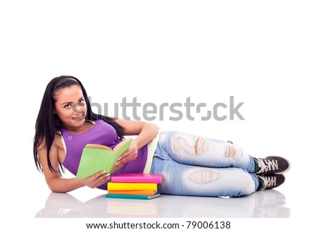 teenage girl with book lying on floor, full length, isolated on white background
