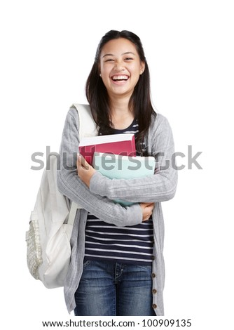 teenage girl with books and bag laughing - stock photo