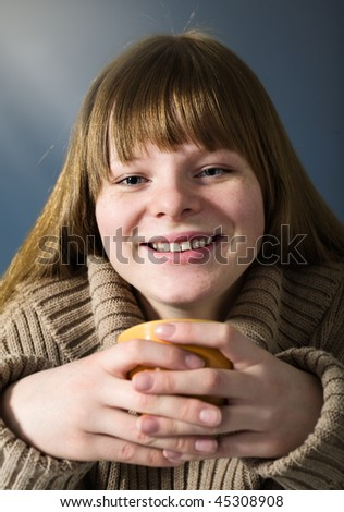 Teenage girl with cup - stock photo