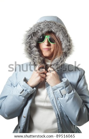 Teenage girl with fashionable winter coat and sunglasses