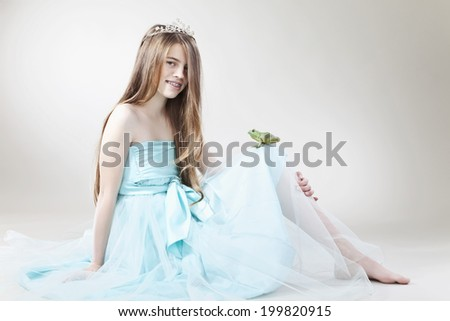 Teenage Girl with frog king, smiling, portrait