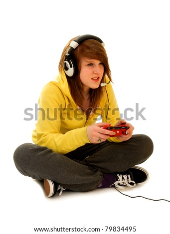 Teenage Girl With Gaming Device Playing Live Video Game on white - stock photo