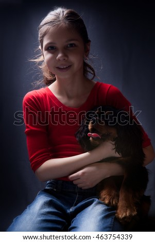 teenage girl with her pet spaniel dog