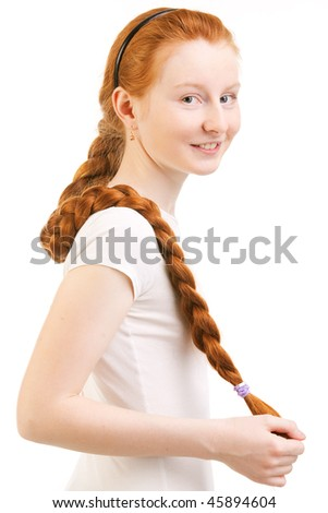 teenage girl with long red plait isolated on white - stock photo