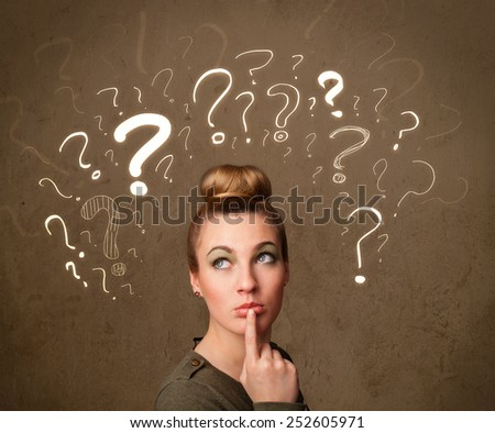 Teenage girl with question mark symbols around her head - stock photo