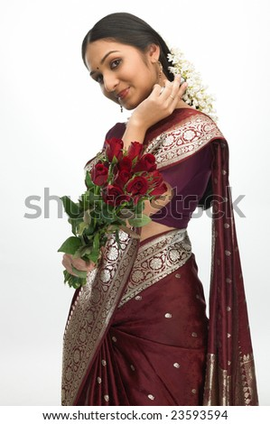 Teenage girl with red roses - stock photo