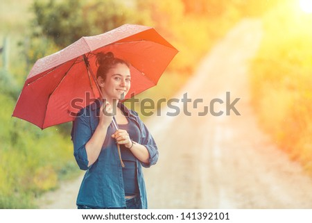 Teenage Girl with Red Umbrella - stock photo